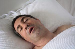 man snoring while he sleeps